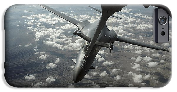 Lancer iPhone Cases - A U.s. Air Force Kc-10 Refuels A B-1b iPhone Case by Stocktrek Images