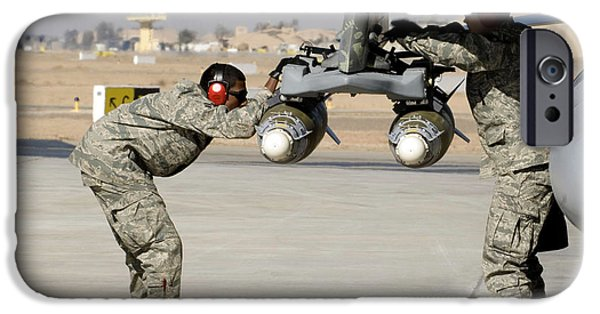 Iraq iPhone Cases - Airmen Inspect F-16 Fighting Falcon iPhone Case by Stocktrek Images