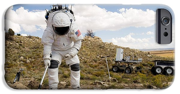 Analyzing iPhone Cases - An Astronaut Collects A Soil Sample iPhone Case by Stocktrek Images