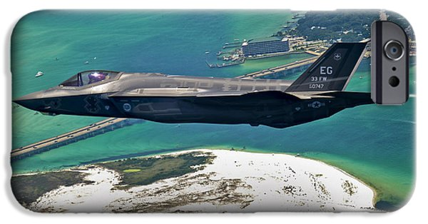Color Image iPhone Cases - An F-35 Lightning Ii Flies Over Destin iPhone Case by Stocktrek Images