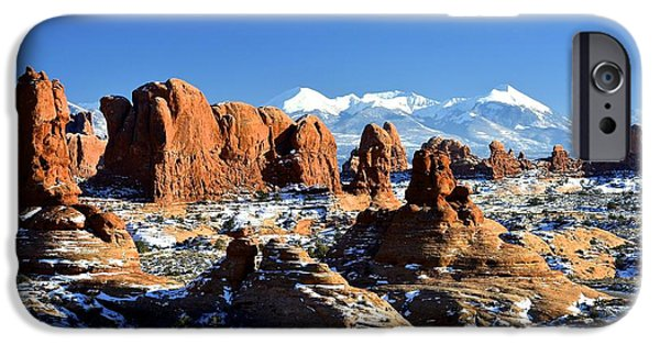 Snow iPhone Cases - Arches National Park range iPhone Case by Russell Cody