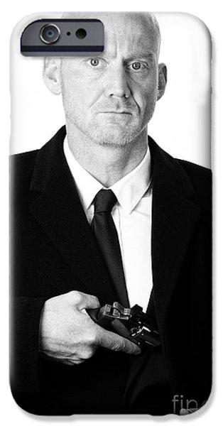 Cut-outs iPhone Cases - Bald Headed Man Wearing Heavy Black Overcoat Showing Revolver In Inside Pocket iPhone Case by Joe Fox