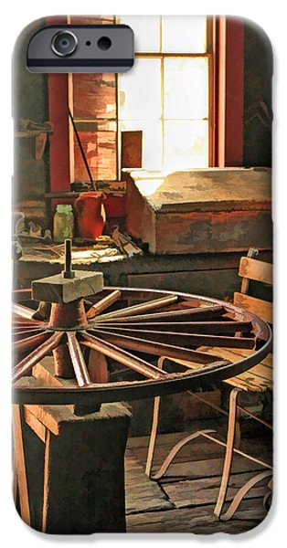 Old Barn Paintings iPhone Cases - Blacksmith Shop Wheel Repair at Old World Wisconsin iPhone Case by Christopher Arndt