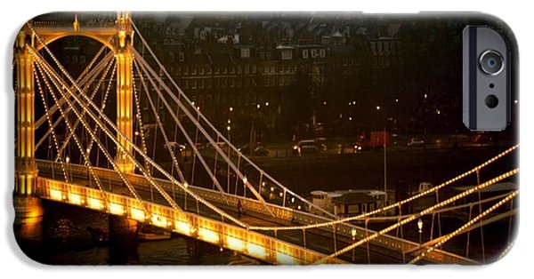 Bay Bridge Mixed Media iPhone Cases - Cable-stayed Gold Sparkle Bridge at night in London iPhone Case by Navin Joshi