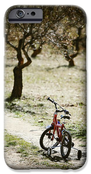 Missing Child iPhone Cases - Childs Bike On A Dusty Road iPhone Case by Paul Bucknall