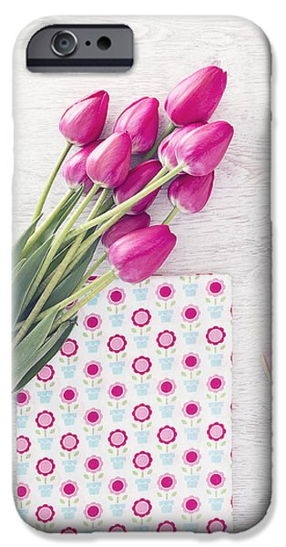 Work Tool iPhone Cases - Collection of spools  threads in pink colors arranged on a white wooden background with tulips iPhone Case by Oksana Ariskina