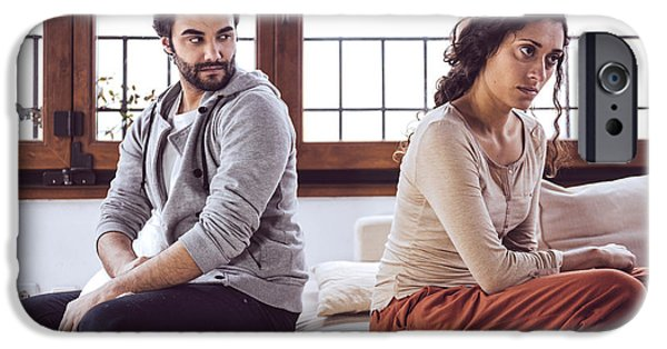 Thinking iPhone Cases - Couple not talking after a fight on the sofa in living room at h iPhone Case by Eduardo Huelin