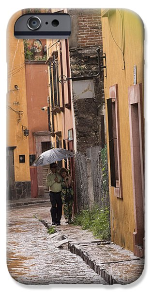 Summer iPhone Cases - Couple walking in the rain through old San Miguel Mexico iPhone Case by Juli Scalzi