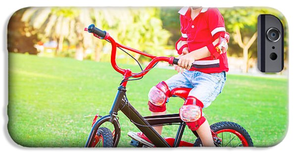 Racing iPhone Cases - Cute little boy riding a bike iPhone Case by Anna Omelchenko