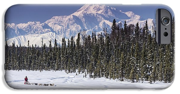 Dog In Landscape iPhone Cases - Dog Musher Martin Buser Runs His Team iPhone Case by Jeff Schultz