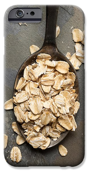 Oatmeal iPhone Cases - Dry Oatmeal Flakes in Spoon iPhone Case by Donald  Erickson