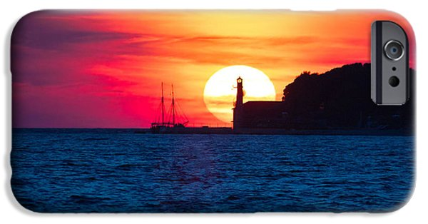 Sailboat Ocean iPhone Cases - Epic sunset view with lighthouse and saiboat iPhone Case by Dalibor Brlek