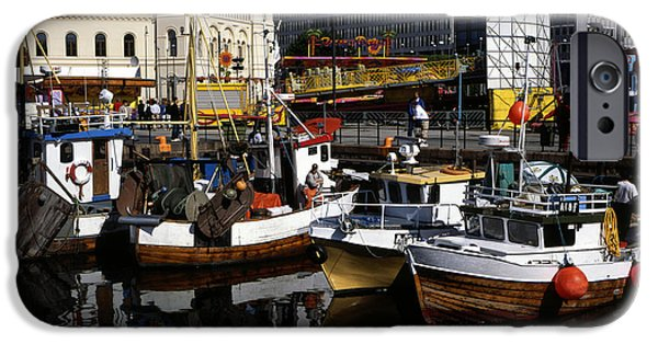 Norway iPhone Cases - Fishing boats moored at the quayside Radhus plassen Oslo Norway iPhone Case by Michael Walters