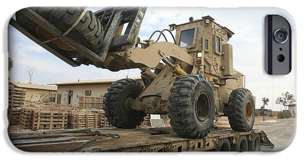 Iraq iPhone Cases - Forklift Is Unloaded Off Of A Logistics iPhone Case by Stocktrek Images