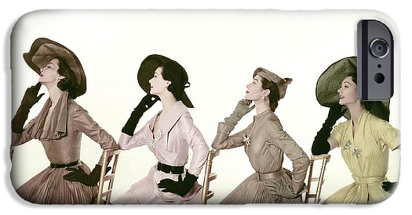 Ball Gown Photographs iPhone Cases - Four Models Sitting In A Line Facing iPhone Case by Conde Nast