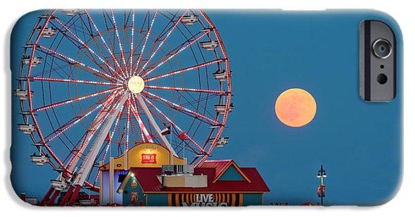 Pleasure iPhone Cases - Full Moon rising above the Gulf of Mexico - Historic Pleasure Pier - Galveston Island Texas iPhone Case by Silvio Ligutti