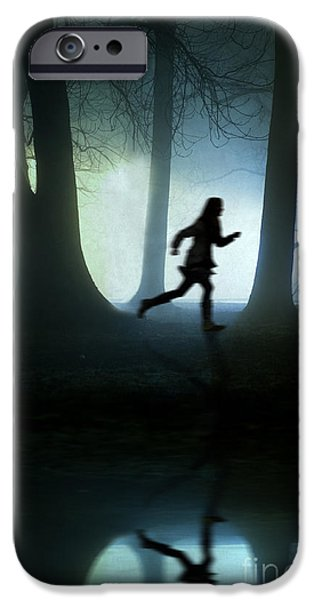 Eerie iPhone Cases - Girl Running At Night In Fog iPhone Case by Lee Avison