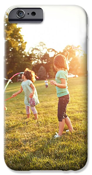 Caucasian iPhone Cases - Girls Playing Together On Evening Lawn iPhone Case by Gillham Studios