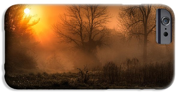 Eerie Photographs iPhone Cases - Glowing Sunrise iPhone Case by Everet Regal
