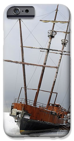 Wintertime iPhone Cases - Grounded Ship in Frozen Water iPhone Case by Oleksiy Maksymenko