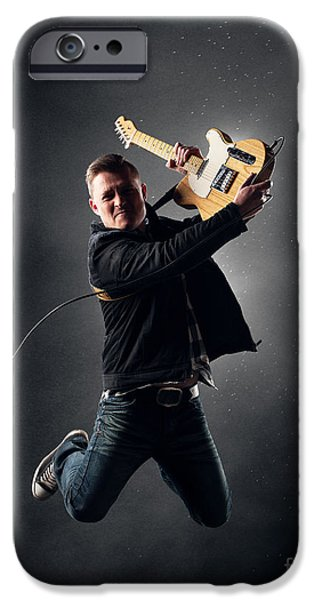 Flight iPhone Cases - Guitarist jumping high iPhone Case by Johan Swanepoel