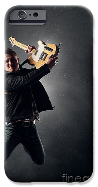 Flight iPhone Cases - Guitarist jumping on stage iPhone Case by Johan Swanepoel