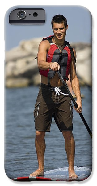 Guy paddling on paddleboard iPhone Case by Christopher Purcell