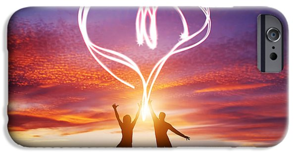 Manifestations iPhone Cases - Happy couple in love jump making heart symbol of light iPhone Case by Michal Bednarek