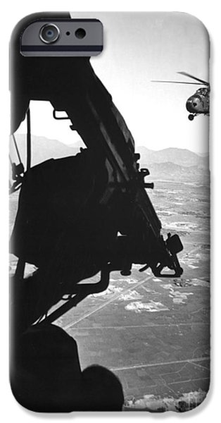 Vertical Flight iPhone Cases - Helicopter And Soldier Approaching iPhone Case by Stocktrek Images