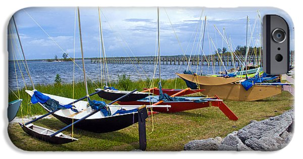 Dragon Greeting Cards iPhone Cases - Homemade outriggers canoes on the Indian River Lagoon in Florida iPhone Case by Allan  Hughes