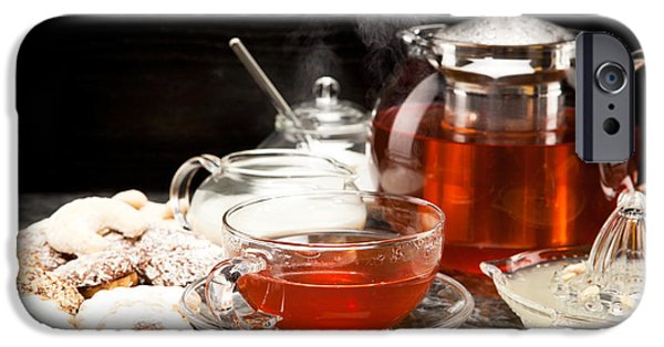Tea Party iPhone Cases - Hot steaming tea with Christmas biscuits iPhone Case by Wolfgang Steiner