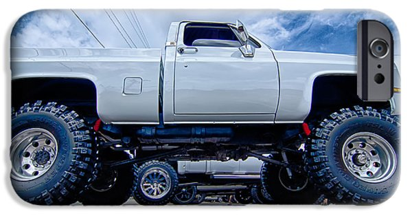 Old Cars iPhone Cases - Huge Truck With Huge Wheels At A Classic Car Show In A Small Tow iPhone Case by Alexandr Grichenko