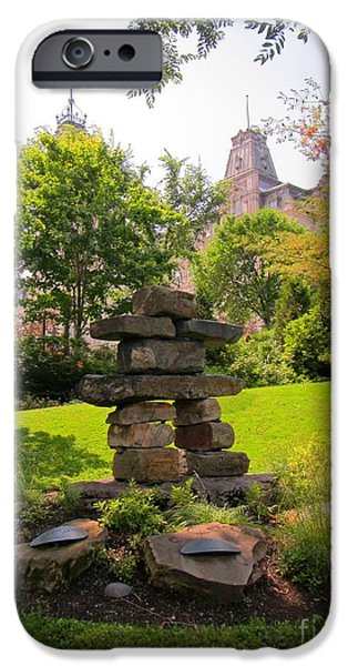 Buildings Sculptures iPhone Cases - Inukshuk on the Grounds of Quebec Parliament iPhone Case by John Malone