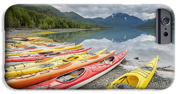 Reflections Of Sky In Water iPhone Cases - Kayaks In A Row On Shore At Eklutna iPhone Case by Remsberg Inc