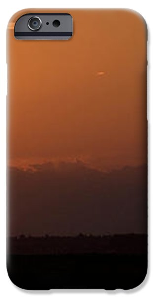 Light airplane landing at sunset on the summer solstice iPhone Case by Ian Middleton