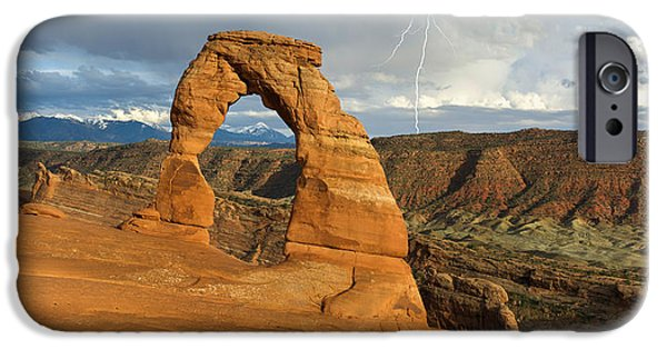 Lightning Photographer iPhone Cases - Lightning at Delicate Arch iPhone Case by Aaron Spong