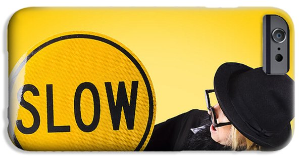 Working Conditions iPhone Cases - Man holding slow sign during adverse conditions iPhone Case by Ryan Jorgensen