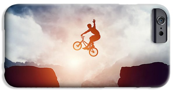 Adrenaline iPhone Cases - Man jumping on bmx bike over precipice in mountains at sunset iPhone Case by Michal Bednarek