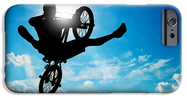 Adrenaline iPhone Cases - Man jumping on bmx bike performing a trick against sunny sky iPhone Case by Michal Bednarek