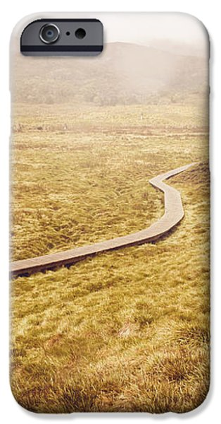 Man on expedition along Cradle Mountain Boardwalk iPhone Case by Ryan Jorgensen