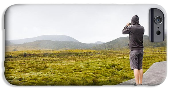 Multimedia iPhone Cases - Man on trekking holiday taking phone photograph iPhone Case by Ryan Jorgensen