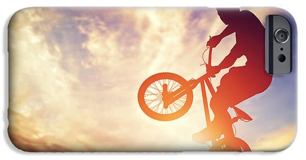 Adrenaline iPhone Cases - Man riding a bmx bike performing a trick against sunset sky iPhone Case by Michal Bednarek