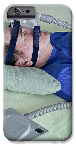 Apnea iPhone Cases - Man Using Cpap Device iPhone Case by Inga Spence