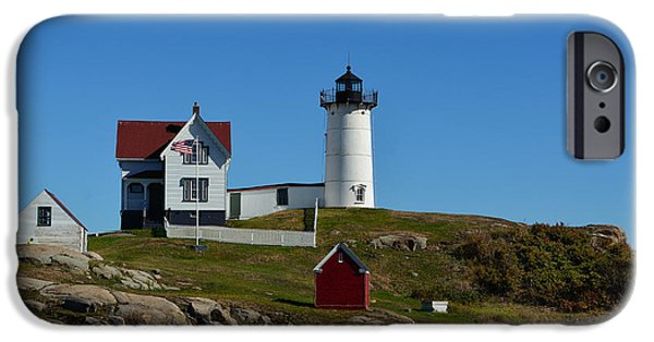 Red Rock iPhone Cases - Nubble Light House in Ogunquit  iPhone Case by Richard Ortolano