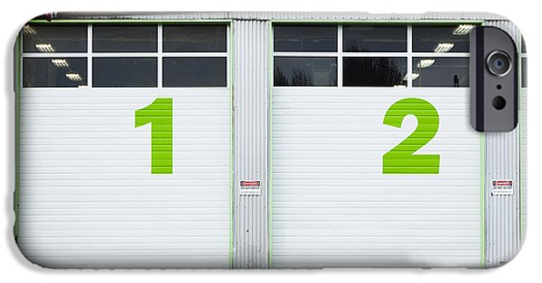 Diagnostics iPhone Cases - Numbers On Repair Shop Bay Doors iPhone Case by Don Mason