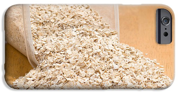 Porridge iPhone Cases - Oat Flakes Spilled Out Of Plastic Container  iPhone Case by Arletta Cwalina