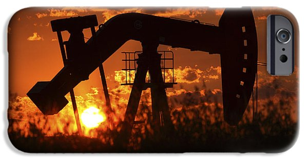 Prairie Landscape iPhone Cases - Oil rig pump jack silhouetted by setting sun iPhone Case by Mark Duffy