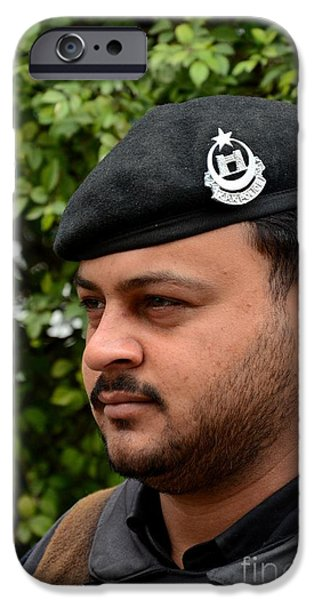 Police Officer iPhone Cases - Pakistani police officer with black beret and insignia Peshawar Pakistan iPhone Case by Imran Ahmed
