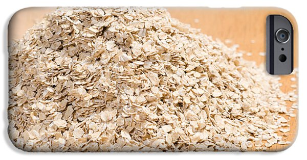 Porridge iPhone Cases - Pile of dried rolled oat flakes spilled  iPhone Case by Arletta Cwalina