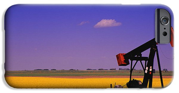 Canola Field iPhone Cases - Pumpjack In A Canola Field iPhone Case by Carson Ganci